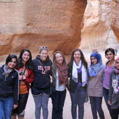 students pose for a photo in petra