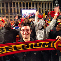 Holding up a Belgium soccer scarf