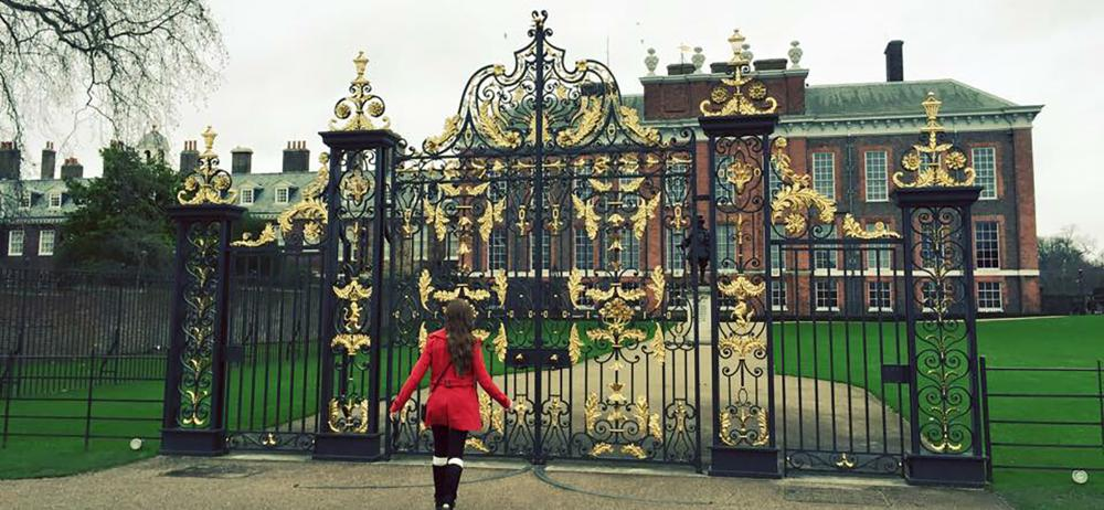 In front of gilded gates