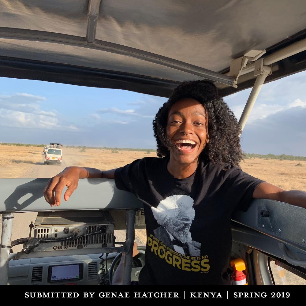 A student smiling in a safari van.