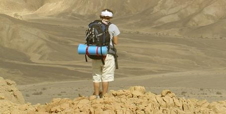 Backpacker and desert
